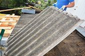 Asbestos Removal Roofer Roof Works. House With Old, Danger Asbestos Roof Tiles Repair And Renovation poster