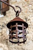 Close-up Of A Street Lamp In Wrought Iron. Medieval Village Of Canale Di Tenno Or Villa Canale, Ital poster
