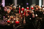 Beautiful, Decorated Table With Flower Decorations And Red Candles. Christmas Evening Or Wedding Par poster
