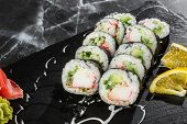 Sushi Rolls With Shrimp, Cucumber And Cream Cheese Inside. Maki Futomaki Sushi Rolls With Shrimp On  poster