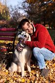 Hipster Stylish Guy Hug His Husky Dog In Autumn Forest.pedigree Dog Concept. Best Friends. Unconditi poster