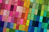 Spectrum of multi colored wooden blocks aligned. Background or cover for something creative or diver poster