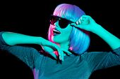 nightlife, fashion and people concept - happy young woman wearing pink wig and black sunglasses in n poster