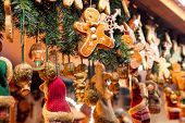 Traditional seasonal items gifts and Christmas decorations at Weihnachtsmarkt (Christmas market) sta poster