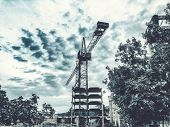 Construction Of A High-rise Building. Cranes Construction Hauling Cargo. Blue Sky. poster