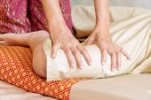 Close Up Hands Of Thai Masseuse Woman Getting Massage Leg For Customer. Leg Massage Treatment In The poster