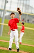pic of little-league  - Little league baseball pitcher on the mound wearing a red jersey - JPG
