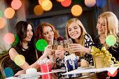 stock photo of hen party  - Portrait of attractive women clinking champagnes with each other during hen - JPG