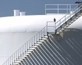 foto of osprey  - Huge oil storage tank with in Florida with an Osprey sitting on the winding staircase with a pattern of shadows - JPG