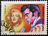 MADAGASCAR - CIRCA 1994: A stamp printed in Madagascar shows Marilyn Monroe and Elvis Presley