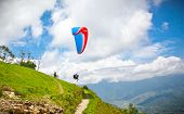 picture of parasailing  - Paraglider flying against the Himalayas - JPG