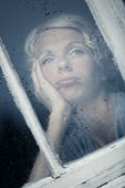 image of boredom  - Bored Woman Looking at the Rainy Weather By the Window Frame - JPG