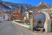 Bridge at the entrance to small french alpine town of Tende in Alps, France.