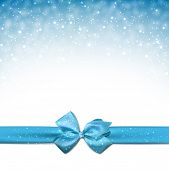 picture of ice crystal  - Winter blue background with crystallic snowflakes with ribbon and gift bow - JPG