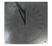 picture of roman numerals  - An old vintage sundial clock made of scratched metal with roman numerals on an isolated white studio background - JPG