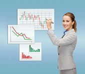 office, business and new technology concept - smiling businesswoman drawing forex chart in the air w
