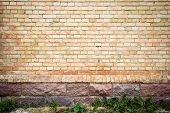image of basement  - Yellow brick wall background with stone basement - JPG