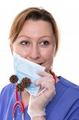 picture of mrsa  - Doctor holding up a surgical mask in front of her mouth - JPG