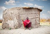 TANZANIA, AFRICA-FEBRUARY 9, 2014: Masai in front of traditional  hut, review of daily life of local