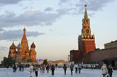 MOSCOW, RUSSIA - JUNE 27, 2008: People walk on the Red Square in evening. The Moscow Kremlin and St.