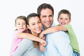 pic of pretty-boy  - Happy young family looking at camera together on white background - JPG