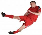 Fit football player playing and kicking on white background