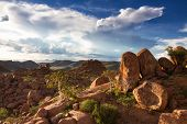 picture of cloud formation  - Rock and cloud formations at Damaraland Namibia Africa - JPG