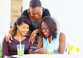 picture of video chat  - happy african friends chatting in social network - JPG