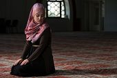stock photo of sufi  - Young Muslim Woman Praying In Mosque  - JPG