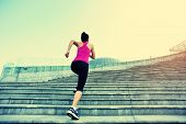 stock photo of ponytail  - Runner athlete running on city stairs - JPG