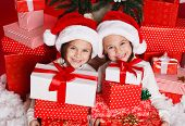 picture of santa baby  - Santa hat Christmas girls holding christmas gifts smiling happy and excited - JPG