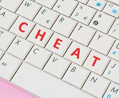 pic of cheating  - close up of a white and pink laptop keyboard with  - JPG