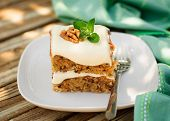stock photo of fancy cakes  - A Piece of Moist Zucchini and Walnut Cake with Cream Cheese Frosting copy space for your text - JPG