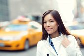 picture of coat  - Young urban professional business woman in New York City Manhattan - JPG