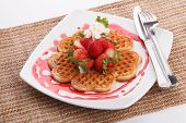 foto of strawberry  - waffle topping with strawberry and decoration with strawberry sauce - JPG