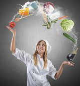 foto of juggler  - Juggler chef play with some ingredients and kitchen tools - JPG