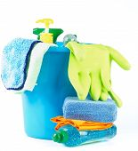 picture of bath sponge  - Arrangement of Cleaning Bottles and Sprays into Blue Bucket with Bath Sponge and Protective Gloves isolated on white background - JPG