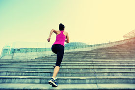 picture of hair motion  - Runner athlete running on city stairs - JPG