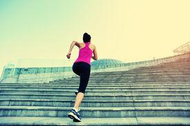 image of japanese woman  - Runner athlete running on city stairs - JPG
