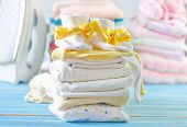 stock photo of girlie  - baby clothes on the blue table - JPG