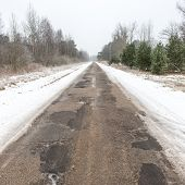 foto of snowy-road  - country snowy road in winter rural area - JPG
