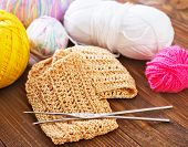 stock photo of knitting  - knitting on a table - JPG