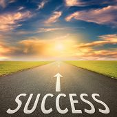 foto of goal setting  - Driving on an empty asphalt road towards the setting sun and sign which symbolizing success - JPG