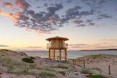 foto of lifeguard  - Wanda Beach Lifeguard lookout tower with sunrise skies - JPG