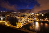 foto of dom  - The Dom Luis I Bridge is a metal arch bridge that spans the Douro River between the cities of Porto and Vila Nova de Gaia Portugal - JPG