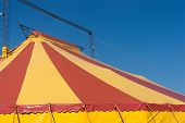 foto of vaudeville  - This dome colorful circus tent on a background of the sky - JPG