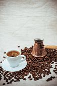 stock photo of pot roast  - Coffee turk and cup of coffee on burlap background - JPG