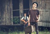 picture of tramp  - Young tramps guys near the lost house - JPG