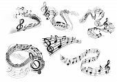 stock photo of classic art  - Swirling musical icons in black and white with flowing staves with clefs and musical notes in different patterns - JPG