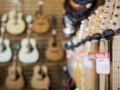 stock photo of guitar  - Guitar shop blurred background - JPG